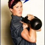 Rosie the riveter with kettlebell